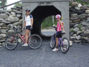 Mom and daughter using FSTA trails for mountain biking